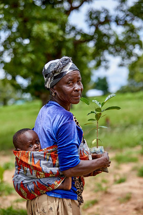 baby holding tree sapling Grow Hope projectc Navio